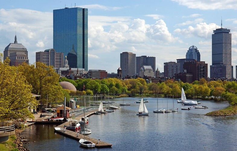 A photo of the Boston skyline featuring the Hancock Tower in Boston, MA.