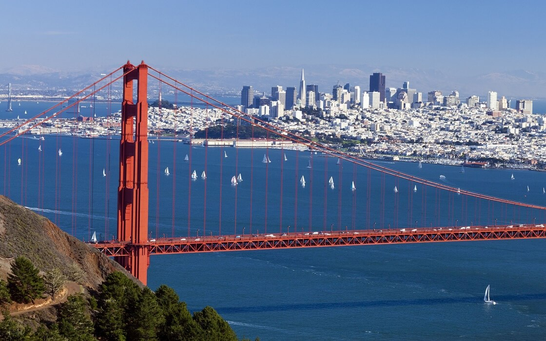 A photo of the San Francisco skyline with the Golden Gate Bridge in the foreground in San Francisco.