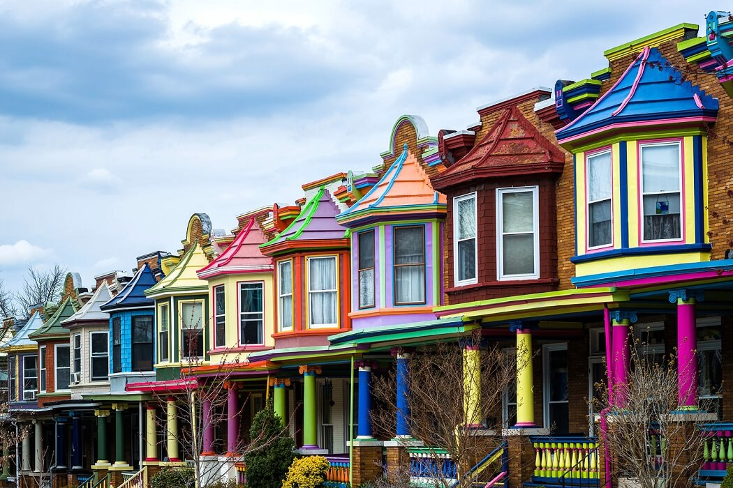 A photo of The Painted Ladies of Baltimore's Charles Village neighborhood (brightly and colorfully painted row houses) in Baltimore, MD.